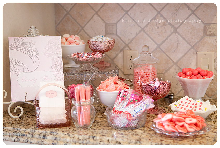 candy in vintage vessels next to paper bags with baby sofia s name
