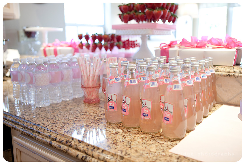 our beverages were individual pink lemonades and water bottles decked