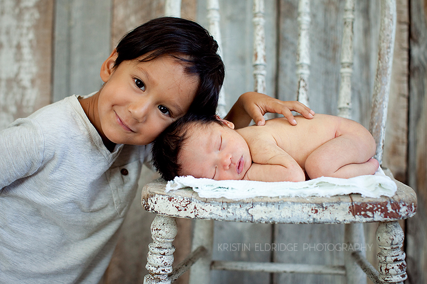 little boy and his newborn brother