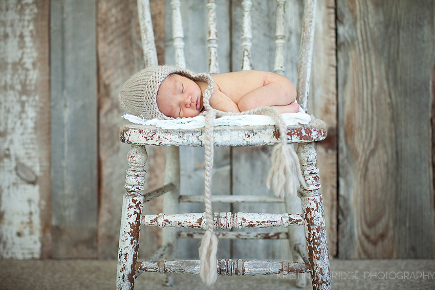 baby sleeping on a chair