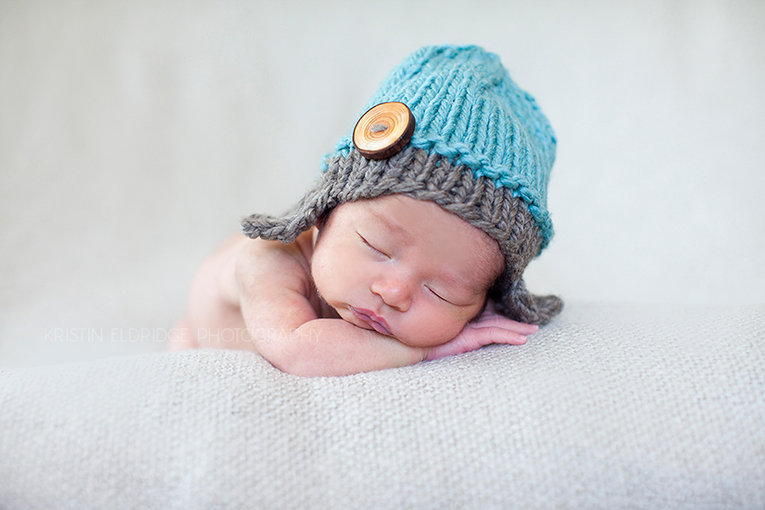newborn in a knitted hat