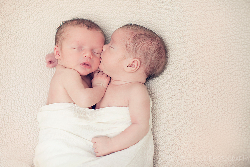 newborn twins kissing