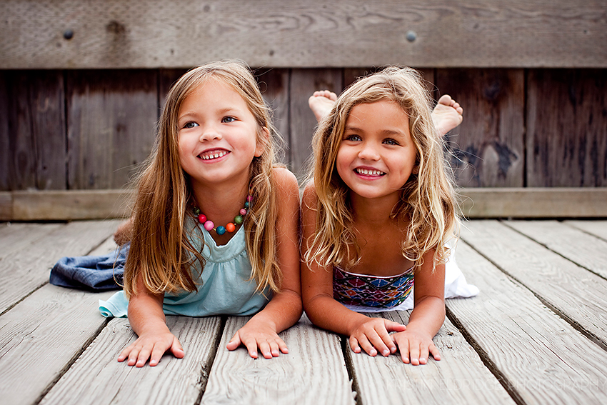 girls on a wood pier at the beach