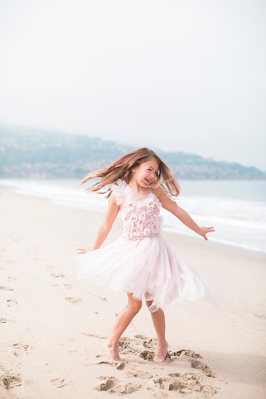 Manhattan Beach Photographer- girl twirling at the beach