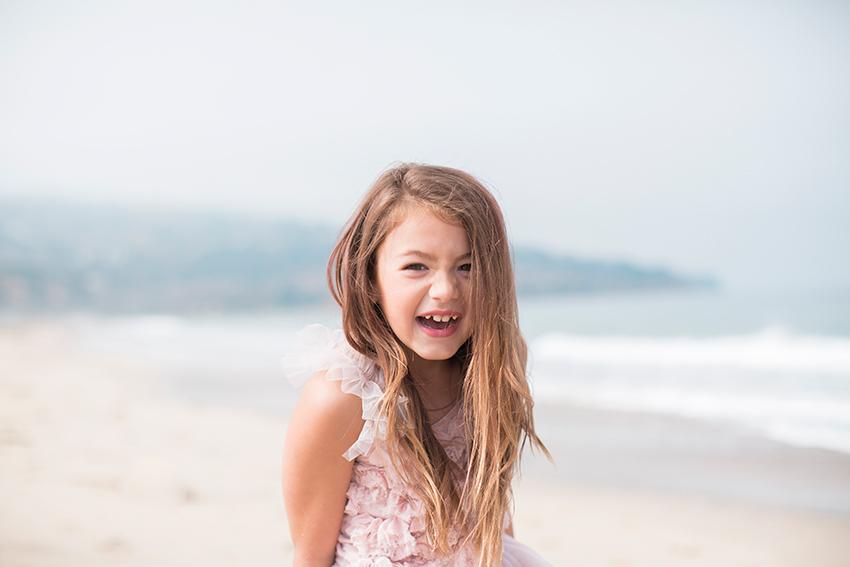 Manhattan Beach Photographer- girl laughing at the beach